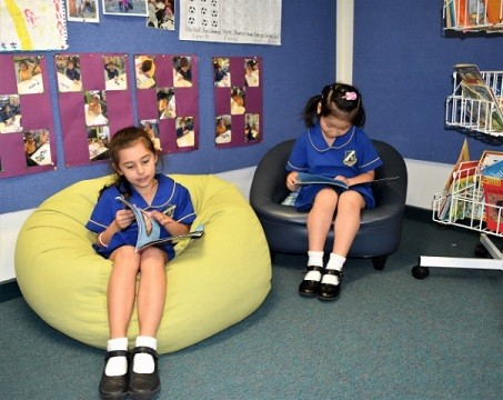 Two girls from Kingsgrove PS reading